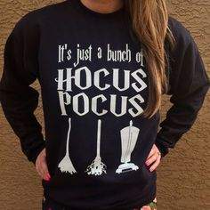 Hocus Pocus Shirt. This Hocus Pocus inspired design features Winifred, Mary and Sarah Sanderson Brooms. And the iconic Its Just A Bumch Of Hocus Pocus Quote! With the perfect blend of three fabrics, this unisex raglan is definitely a keeper. 50% polyester/25% combed ring-spun cotton/25% rayon jersey • 4.3 oz. • fabric laundered for reduced shrinkage FOR BASEBALL + CREWNECK SWEATER Girls Order a size down Guys Order normal size - SIZE CHART - UNISEX SIZING (BASEBALL + CREWNECK) XS...
