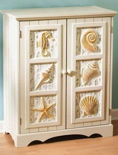 Found it at wayfair key largo seascape cabinet in ivory for Kitchen cabinets lowes with seashell wall art decor