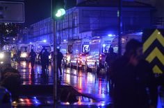 Ambulances are seen near the scene of an attack in Istanbul, on New Year's Day, early Sunday, Jan. 1, 2017. An assailant believed to have been dressed in a Santa Claus costume and armed with a long-barrelled weapon, opened fire at a nightclub in Istanbul's Ortakoy district during New Year's celebrations, killing dozens of people and wounding dozens of others in what the province's governor described as a terror attack. (Depo Photos via AP)