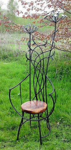 This beautiful wrought iron chair design is unique and perfect to be placed in lawn or in your garden. It breaks all the straight line phenomenon and presents the curved, molded structure. The back of the chair presents the leaves and stems of a plant and the upper part shows the blooming flower bunch in the most dramatic way. Its stylish and grand.
