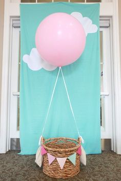Host a Hot Air Balloon 1st birthday party -- love this DIY photo booth idea. Welcome