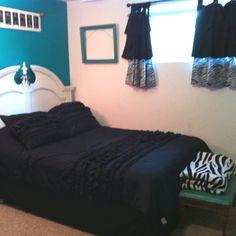 Dark teal, black, white, and zebra bedroom!