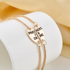 Partners in Crime BFF Friends 2 PC Charm Bracelet Bracelets! One for you, one for your BFF.Eterna-Coated for Lasting ShineNickel + Lead-FREE Heart Friendship Bracelets, Best Friend Bracelets, Best Friend Jewelry, Friendship Gifts, Heart Bracelet, Bracelet Set, Bracelets For Men, Silver Bracelets, Bangle Bracelets