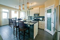 Kitchen and Nook, Morningside Showhome. Nook, Kitchen, Table, Furniture, Home Decor, Nooks, Cooking, Decoration Home, Room Decor