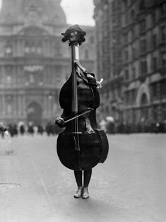 walking violin in philadelphia mummers' parade, 1917  a person dressed as a violin in philadelphia's mummers' parade, january 2, 1917. photo by otto bettmann.