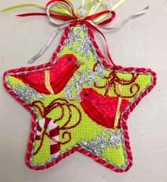 double cording on Raymond Crawford needlepoint star with red birds