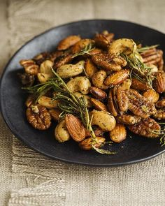 Spicy Fried Mixed Nuts  Makes 3 Cups  2 tablespoons peanut oil   1 cup unsalted cashew nuts   1 cup unsalted almonds   1 cup unsalted macademia nuts   1 rosemary twig, just the leafs   1 tablespoon flaky sea salt   1 tablespoon sugar   1/2 teaspoon ground cumin   1/2 teaspoon dried thyme   pinch of ted chili flakes