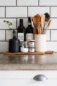 Kitchen details on concrete countertop. Photographer Therese Romell.