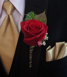 gold and black red rose boutonniere for prom