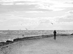 Lonely runner on a winter beach. Bornholm, Denmark.