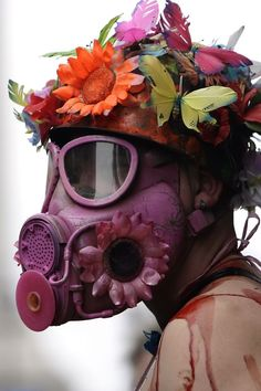 - I felt this piece complemented the idea of something beautiful, flowers… Less war! Ironic gas mask and lovely flowers! Gas Mask Art, Masks Art, Gas Masks, Cyberpunk, Arte Dope, Arte Van Gogh, Activist Art, Protest Art, Political Art