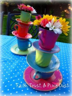 take old tea cups, paint them fun colors, glue them together in a crazy way and tada!