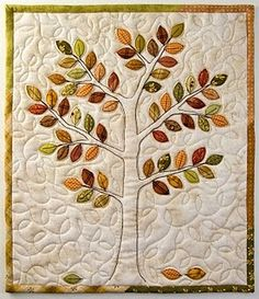 Pretty little fall quilt.  This would make an awesome family quilt, by putting names on the leaves.