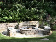 This fire pit area, which can seat 12 to 15 people, is modeled after an outdoor…