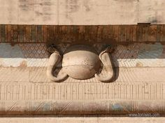 At the top of the pylon, in the Edfu temple, stands a winged sun disk flanked by two cobras. The symbol is a representation of the soul's ascent to the Divine, with the help of the serpents of wisdom and knowledge. The same is represented in most temples as protection symbols.