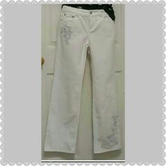 Ann Taylor Loft jeans size 2 These beautiful jeans are wonderfully done with beautiful embroidered metallic silver and white accents on the legs and at the pocket in the front. This listing is for the pants only. Ann Taylor Loft Jeans Boot Cut