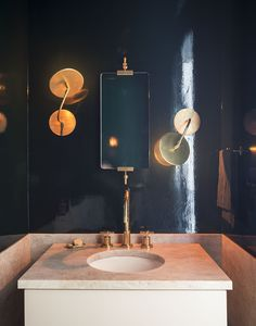 Powder room with lacquered midnight blue walls by Workstead, Matthew Williams photo  Remodelista