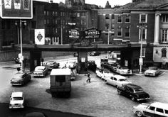 In 1934, the Sumner Tunnel opened beneath the harbor, connecting East Boston and eventually Logan International Airport to the rest of the city. In this photo, automobiles enter the Sumner on April 24, 1958. Almost exactly a year after this picture was taken, on April 30, 1959, more than 1,000 people attended a groundbreaking ceremony for construction of a second tunnel to run parallel to the then–25-year-old Sumner.
