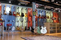 Free Shirt Wednesday - Fat Tone Guitars - Effects Bay Guitar Storage, Guitar Display, Violin Shop, Guitar Shop, Music Man Cave, Store Displays, Retail Displays, Sleep On The Floor, Guitar Wall