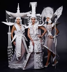 three models don a series of sculptural paper dresses inspired by mongolian wedding costumes