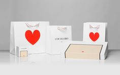 """Cocolobo is a high-end shopping boutique that caters exclusively to strong women with a confident and in vogue fashion sense. For the naming, we played with the shop's main patrons' characteristic duality, in a catchy and fun play with words: """"Coco"""" (coco…"""