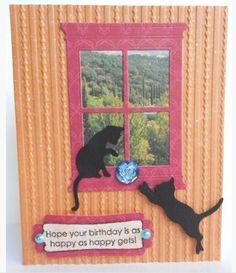 Kitties in a window