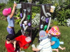 Easy Homemade Water-wall with recyclables.  Keeps the kids cool and entertained for hours!