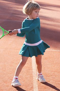 Shop designer tennis dresses for children. Kayla tennis dress with white insets designed and made in UK by Zoe Alexander.