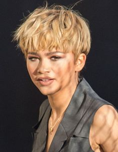 Zendaya's messy short blonde pixie cut at the Yves Saint Laurent Fall 2016 show in Los Angeles | allure.com