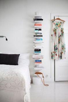 Lovely, space-saving vertical bookshelf in the bedroom | Bloglovin, from Elle Deco Sweden ~ Photo: Johan Sellen | Tiny Homes