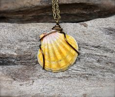 Sunrise Shell Necklace: https://www.etsy.com/listing/233756303/big-sunrise-shell-necklace-made-in?ref=shop_home_feat_2 SheSellsSeashells Team