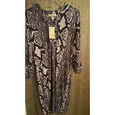 Michael Kors Snake Print dress Brand New Fabulous Michael Kors snake skin dress  Never warm and in mint condition. Perfect for a night out on the town.  No trades. Dresses Mini