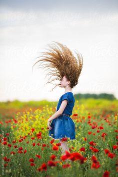 Girl in a field of poppies by jovanarikalo | Stocksy United