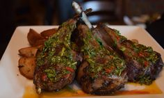 Grilled Lamb Chops with piquillo pepper-mint chimichurri over roasted Greek potatoes and wilted greens // Green Valley Grill Menu - Greensboro NC