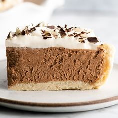 In this Homemade French Silk Pie recipe, a flaky pie crust is filled with a chocolate cream filling and topped with homemade whipped cream! This chocolate silk pie recipe is made from scratch and tastes even better than Baker's Square or Village Inn! Chocolate Silk Pie, Best Chocolate Desserts, Just Desserts, Chocolate Cream, Chocolate Chiffon Pie Recipe, Pie Recipes, Dessert Recipes, Homemade Whipped Cream, Homemade Pie