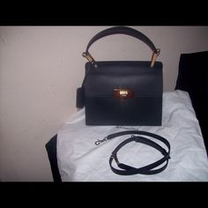 BALENICIAGE BLACK PURSE SMALL This bag has been used one time measure 13 x 11 has a shoulder strap or tote. Balenciaga Bags