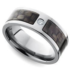 Diamond Accent Carbon Fiber Men's Wedding Ring in Titanium https://www.brilliance.com/wedding-rings/diamond-accent-carbon-fiber-mens-band-7-mm-titanium