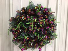 A personal favorite from my Etsy shop https://www.etsy.com/listing/533681019/halloweenfall-deco-mesh-wreath