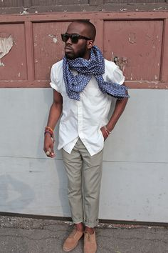 Never underestimate the importance of a print accessory. If he didn't have the scarf, he'd look like a waiter.