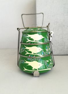 I have a soft spot for cool, reusable gear for carrying delicious home-made meals... I love the whimsical birds on these and the vibrant color. Would be so pretty as bowls at a party too!