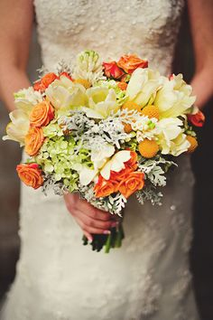 Love this color combo- yellow and orange wedding bouquet with roses, tulips, hydrangea and billy balls | photo: Jason Mize Photography
