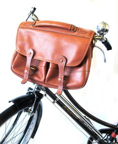 Thrift store finds re-purposed...and for a much needed cause! Handlebar bags can now match your outfit too!