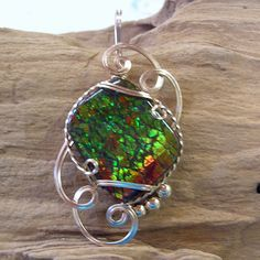 Ammolite in 14kt gold filled wire sculpture.  From Contemporary Concepts Handcrafted Jewelry.  $135.00