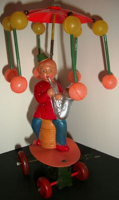 """Vintage Tin & Celluloid Boy with Saxophone """"wind up"""" (Made in Occupied Japan)"""