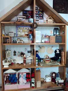 If I could just find a wooden bookshelf...I could make a cute doll house...now for the furniture.