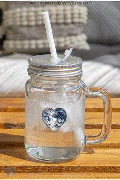 * Earth Heart Mason Jar Mug / 12 oz Drinking Glass by #Gravityx9 at Spreadshirt * Incl. Screw cap and reusable white drinking straw. * A fun gift for friend, gift for coworker or family. * This design is available on coffee mugs, scarves, home decor and more. * Drinking Glass * Mason Jar Drink Ware * Earth Day Earth Heart * I Love Earth * #drinkingglass #masonjar #masonjarmug #mug #earth #earthheart #earthday 0920