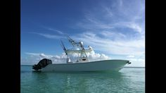 Gulfstream Yachts boat with upper station in crystal clear water against blue sky Center Console Fishing Boats, Crystal Clear Water, Gone Fishing, Yachts, Boating, Ocean, Sky, Blue, Sports