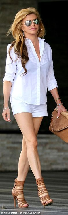Leggy lady: The 45-year-old looked younger than her years in the all white outfit