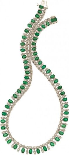 "EMERALD, DIAMOND, WHITE GOLD NECKLACE The necklace features oval-shaped emeralds measuring 6.00 x 4.00 x 2.80 and weighing a total of approximately 23.00 carats, enhanced by full-cut diamonds weighing a total of approximately 2.80 carats, set in 14k white gold. 17"" x 3/8"""
