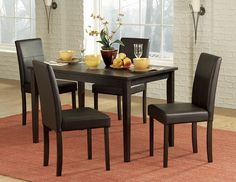 Dover 5Pcs Dining Set 2434(Dining Table,4 Side Chairs)Dark brown PVC chairs compliment a rich espresso finished table in the transitional Dover Collection. This cleanly designed set seats four, making it a perfect addition to your casual dining space.Features:Chair Sold as 4-Piece Set OnlyDover CollectionBlack FinishDimensions:Dining Table : 29.5 x 47.25 x 29.5HSide Chair: 17.5 x 21 x 35.5Hs.b